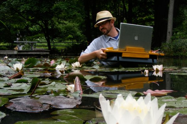 Click the image for a view of: Nathaniel Stern scanning in the lily pond